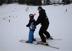 Daniel Wallhead having a ski lesson