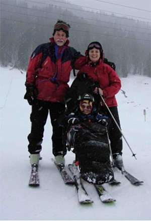 The Wallhead family skiing togther