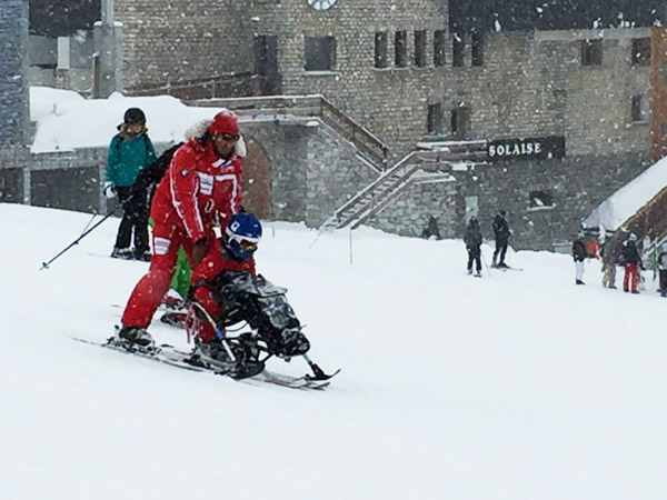 Josua Aspin sit skiing in Val d'Isere