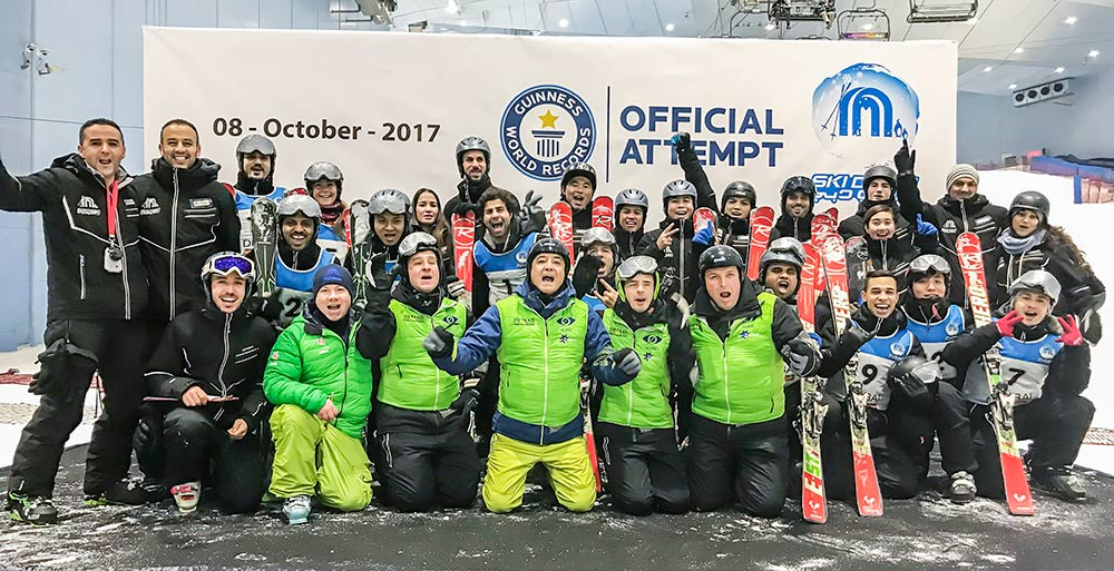Group photo of the team of blind skiers and their support team at Ski Dubai