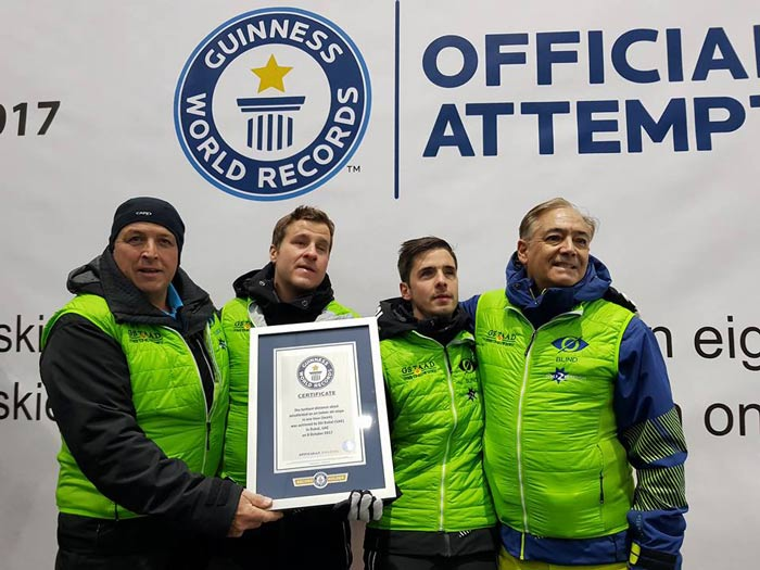 The blind skiers holding their world record certificate